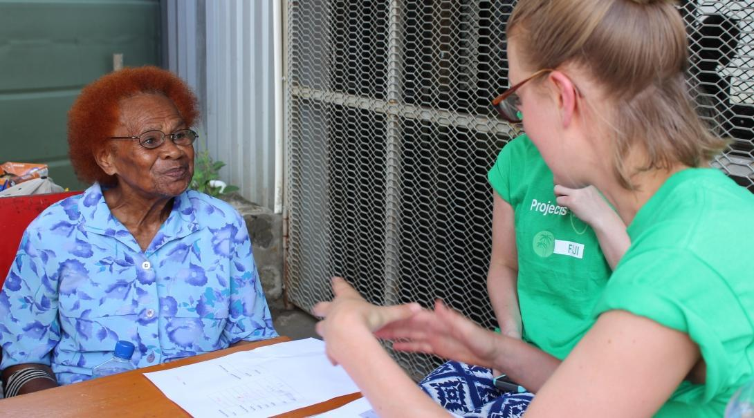 A young intern is pictured with an elderly local lady discussing her medical experience whilst she is on her nutritional internship in Fiji with Projects Abroad.